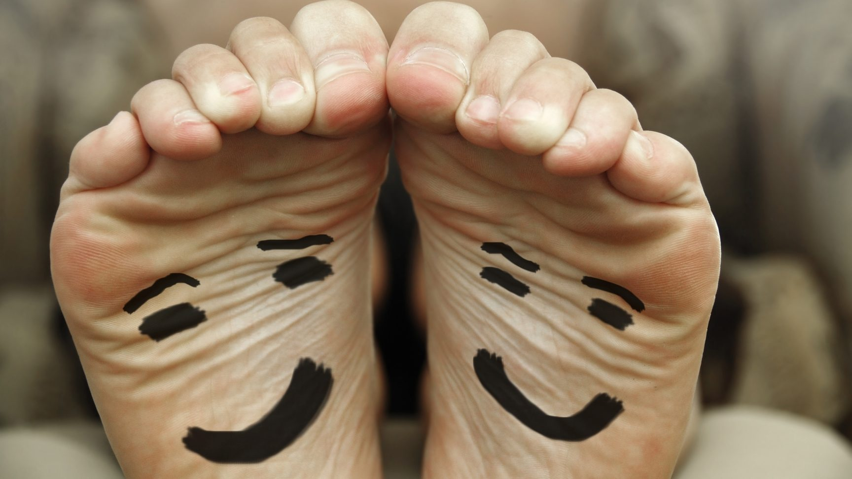 Feet with smiley faces